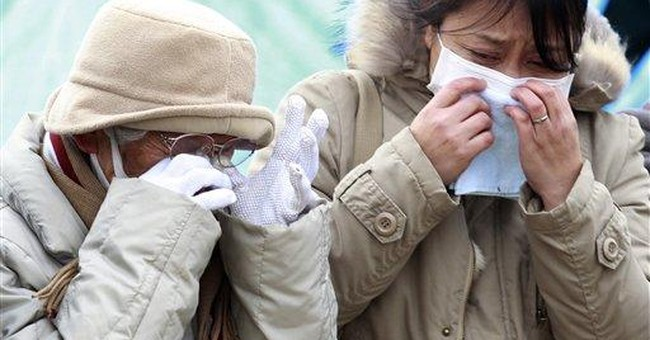 Japanese police say disaster death toll near 9,100