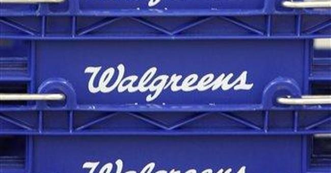 Walgreen fiscal 2Q profit climbs but shares tumble