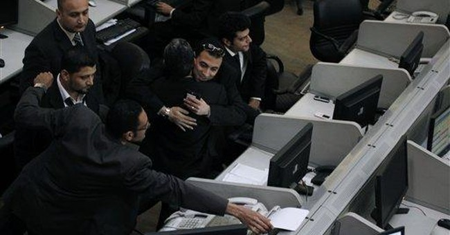 Egypt exchange plunges on reopening after uprising