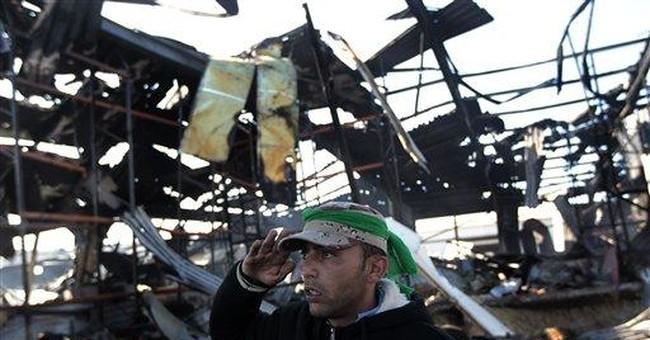 Pro-Gadhafi Libyans strut in Tripoli, critics cool