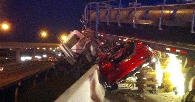 18-wheeler ends up hanging off Fort Worth highway