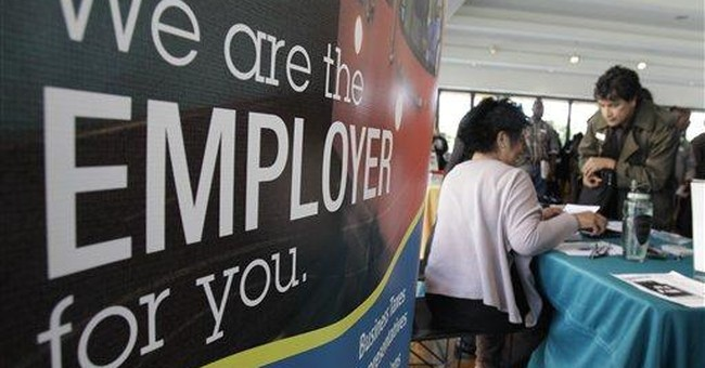 Applications for unemployment aid drop slightly