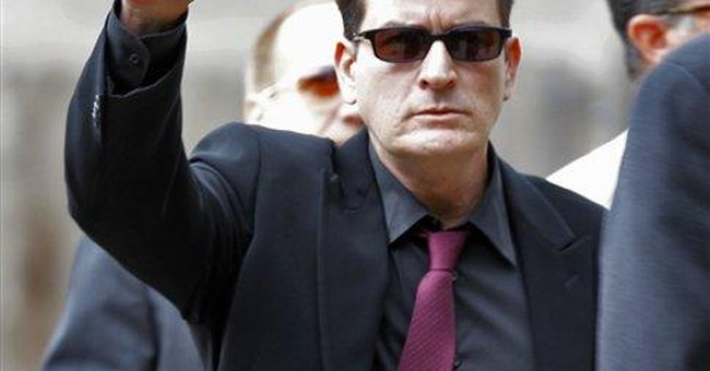 Rep says Charlie Sheen didn't hire book agent