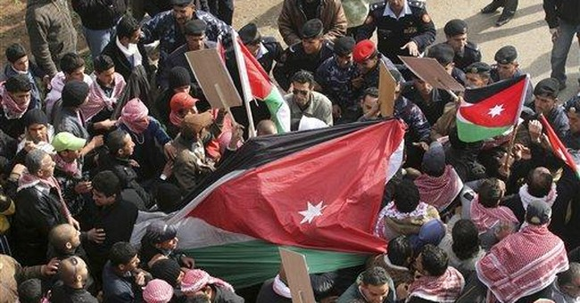 Government backers, police attack Jordan protest