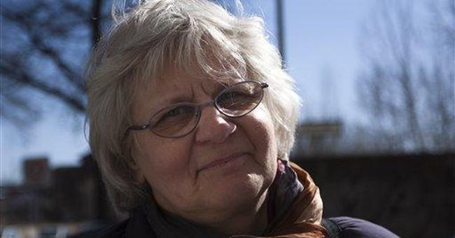 German woman devoted to removing Nazi graffiti