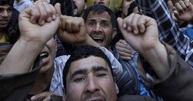 Gangs of armed young men roam Syrian seaside city