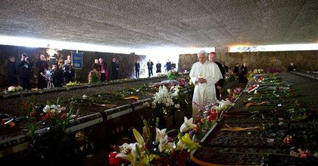 Pope visits memorial to Nazi victims in Rome