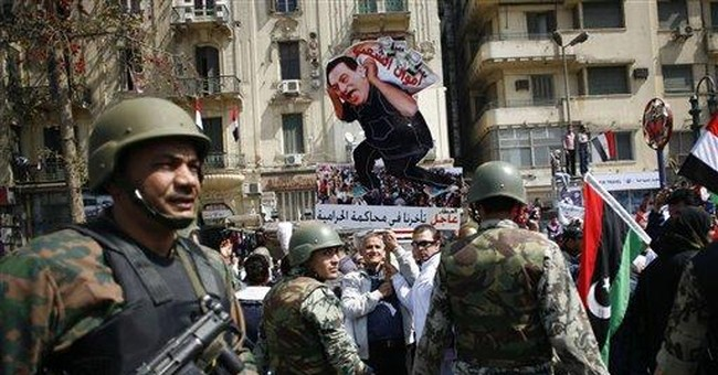 Egypt to lift emergency laws before September vote