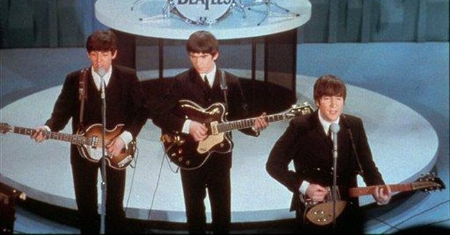 Website to pay $950,000 for posting Beatles hits