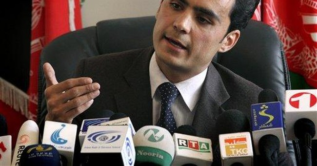 Karzai's adviser questioned in corruption case