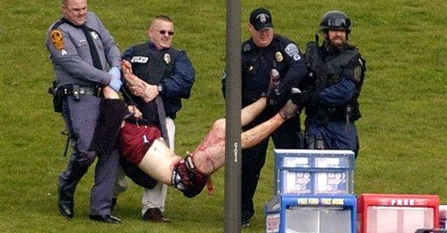 Virginia Tech fined $55K for response to shootings