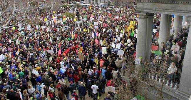 Thousands rally in NH against budget proposal