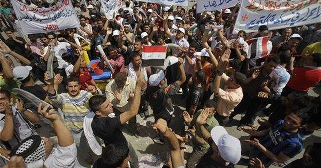 Officials: Bomber kills 3 outside Iraqi mosque