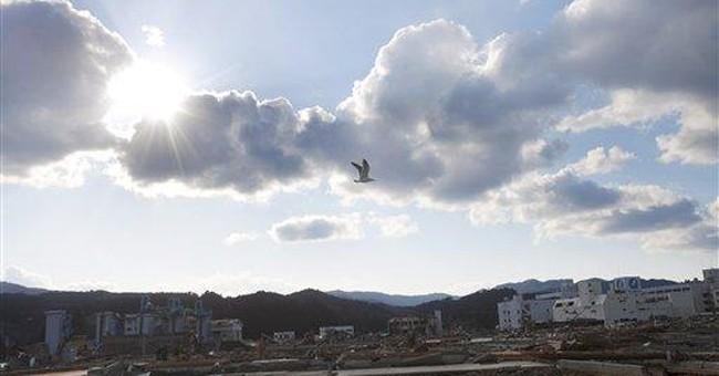 Japan: post-tsunami, town wonders if to rebuild