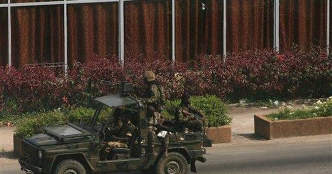 Charges fly in killings of 1,000 in Ivorian town