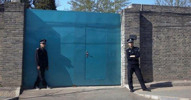 China blocks well-known artist from boarding plane