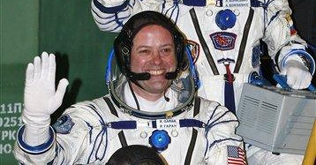 US-Russian crew blasts off for orbiting station