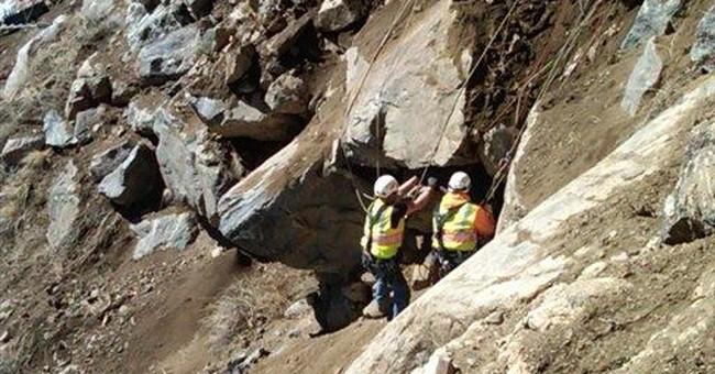 Crews remove huge boulders along Colo. highway