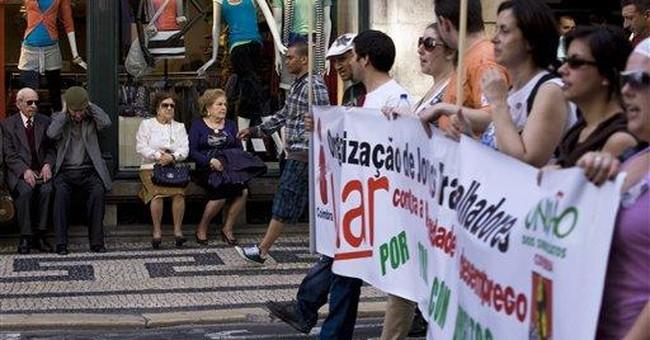 Portugal rating cut again, deepening debt crisis