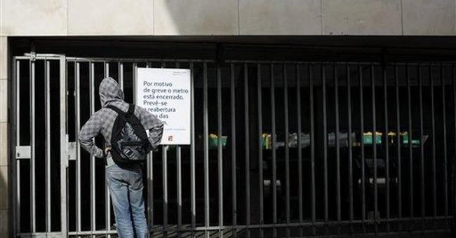 Despite aid request, Portugal's outlook uncertain
