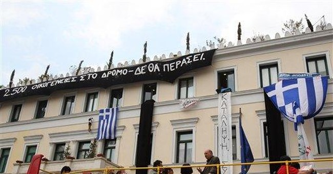 Ex-minister: Greece urged to seek IMF aid in 2004