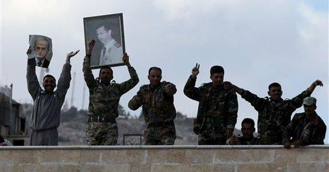 Syria's Assad makes gesture to Kurds amid protests