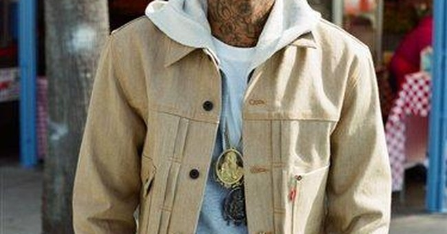 Rapper Wiz Khalifa surges to fame with new album