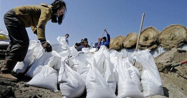 Volunteers fill gap after farmer dies sandbagging