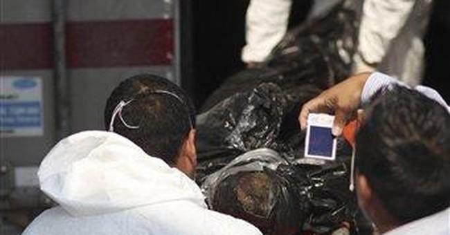 72 bodies at burial site as Mexicans seek missing