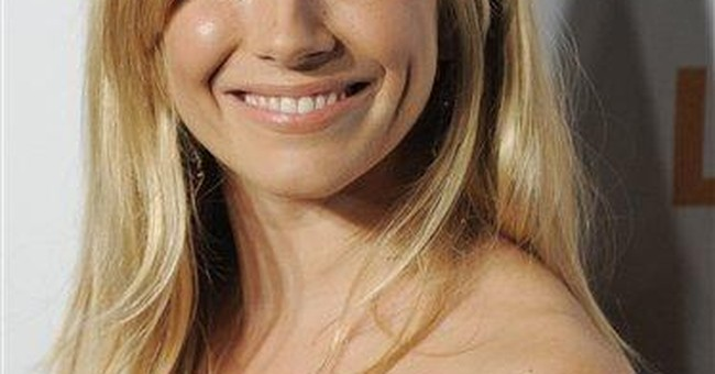 Sienna Miller: still suing over tabloid phone hack