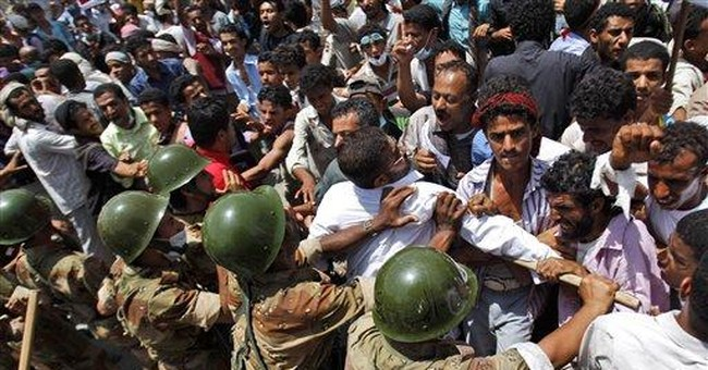 Yemenis demanding leader's ouster shot in 2 cities