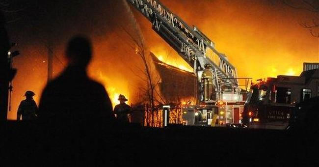 Fire destroys landmark former Ill. clock factory