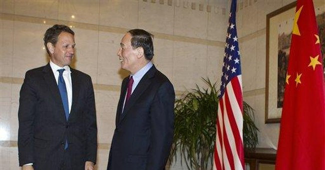 Geithner presses Beijing on Iran, currency