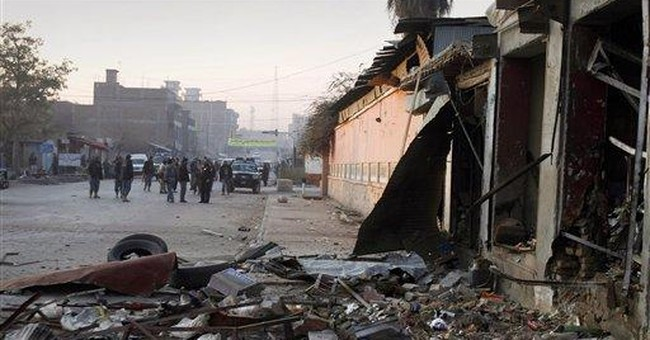 10 die as Taliban storm Afghan government building