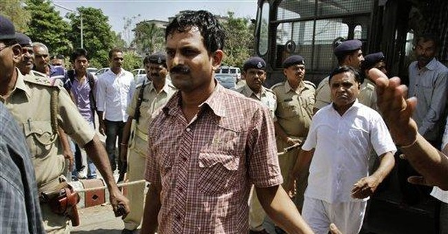 India sentences 18 to life in jail for 2002 riots