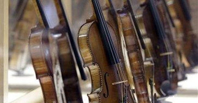 Exhibit of 18 violins tells story of the Holocaust
