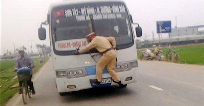 Fleeing bus driver takes Vietnam cop on wild ride