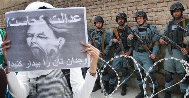 Son of slain Afghan peace council head takes over