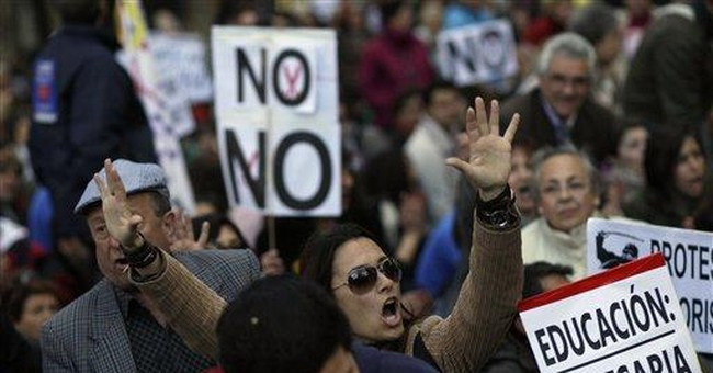 Spain approves more cuts to education, health