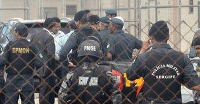 Rioting inmates hold 80 hostages in Brazil