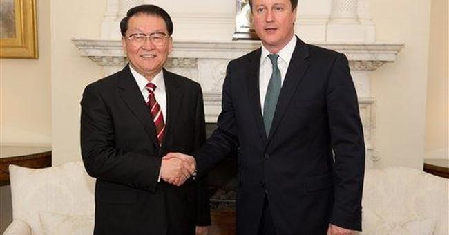 UK raises Briton's murky death in China talks