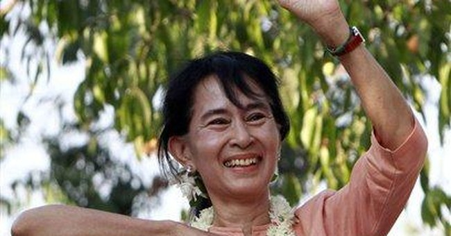 Suu Kyi to leave Myanmar for 1st time in 24 years