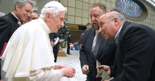 Pope gets rare, scaled visitor at general audience
