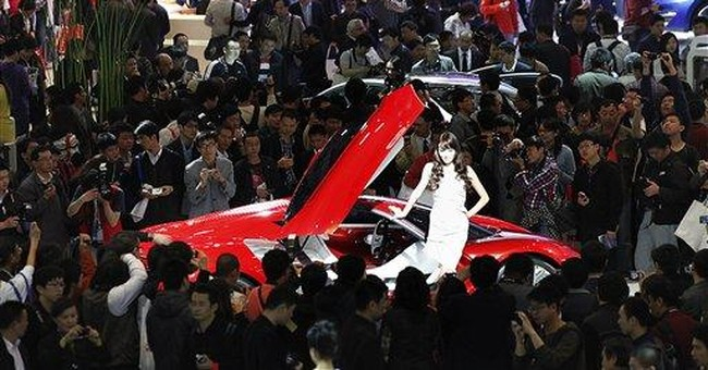 Automakers unveil new models at Beijing show