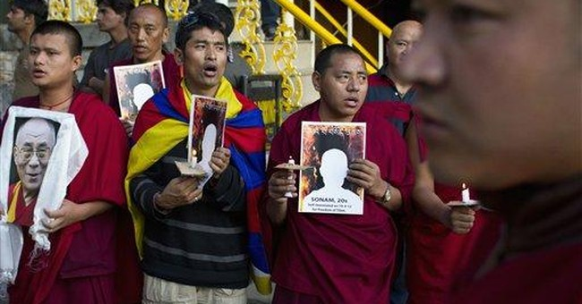 Group says 2 lay Tibetans set themselves on fire