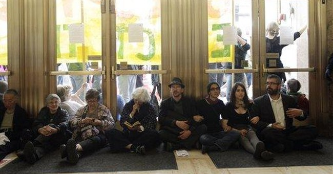 Protesters crash Wells Fargo shareholder meeting