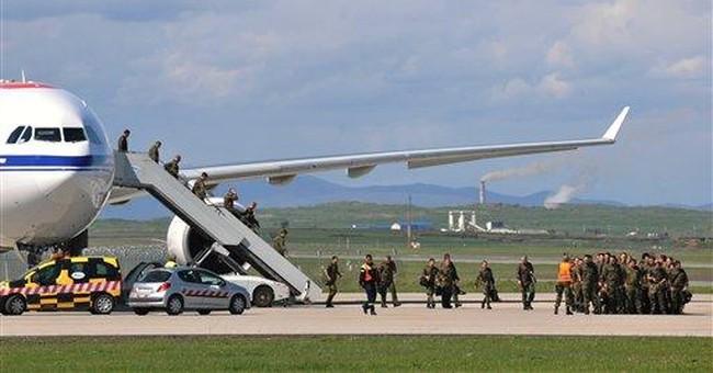 NATO reinforcements begin arriving in tense Kosovo