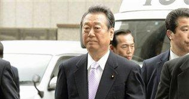Japan political power broker acquitted in scandal