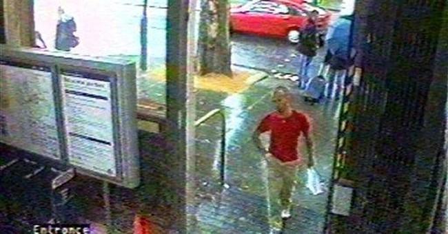 Coroner: Spy likely slain by mystery killer