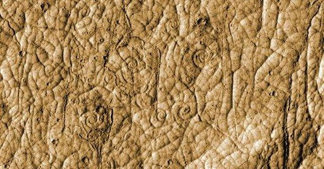 Student researcher spies odd lava spirals on Mars